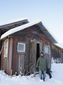 Markus shows us the outhouse of Flurlundar farm, built of wastewood. Photo: Agata Mazgaj